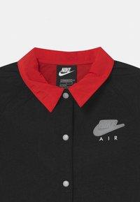 Nike Sportswear - AIR COACH  - Light jacket - black/university red/white - 2