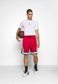 Jordan - JUMPMAN DIAMOND SHORT - Sports shorts - gym red/black/white - 1