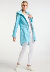 Schmuddelwedda - Waterproof jacket - light blue - 1