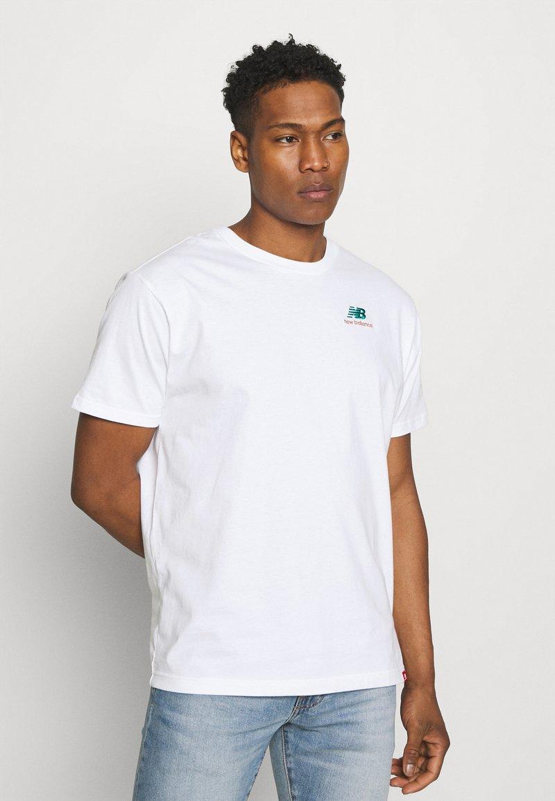 New Balance - ESSENTIALS EMBROIDERED TEE - Basic T-shirt - white