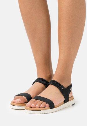 RAINIA - Sandals - black