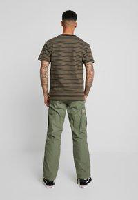 Carhartt WIP - REGULAR COLUMBIA - Cargo trousers - dollar green rinsed - 2