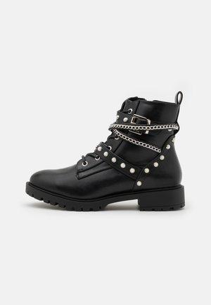 PARISS - Lace-up ankle boots - black