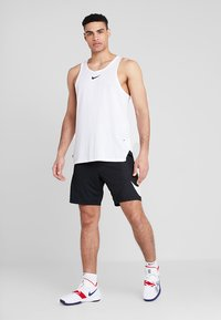 Nike Performance - SHORT - Sports shorts - black/white - 1