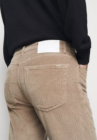 HUGO - Trousers - light pastel brown - 4
