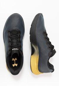 Under Armour - CHARGED PULSE - Zapatillas de running neutras - black/metallic gold - 1
