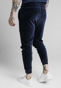 SIKSILK - ALLURE CUFFED PANTS - Tracksuit bottoms - navy - 2