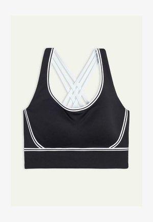 MIT INNENSEITE AUS SUPIMA - Medium support sports bra - schwarz black/white