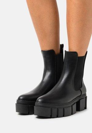 ROXI - Platform ankle boots - black