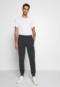 EA7 Emporio Armani - PANTALONI - Tracksuit bottoms - night blue - 1