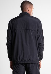 K1X - Training jacket - black - 2