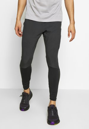 SWIFT PANT - Verryttelyhousut - black/reflect black