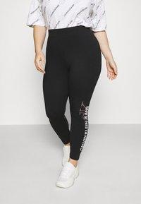 Calvin Klein Jeans Plus - PLUS VERTICAL LOGO - Leggings - Trousers - black - 0
