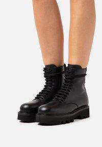 Furla - RITA ARMY BOOT  - Platform ankle boots - nero - 0