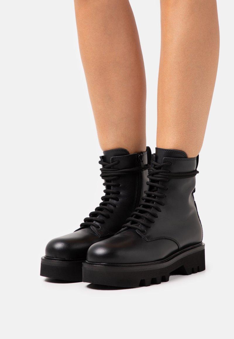 Furla - RITA ARMY BOOT  - Platform ankle boots - nero