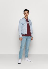 Levi's® - 502™ TAPER - Džíny Slim Fit - light-blue denim