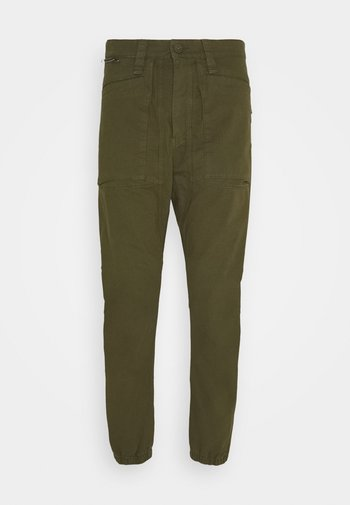 EKSTRO - Trousers - green