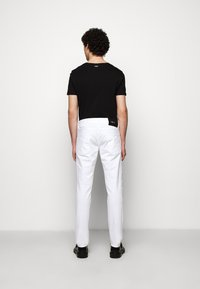 Just Cavalli - PANTALONE - Slim fit jeans - optical white - 3