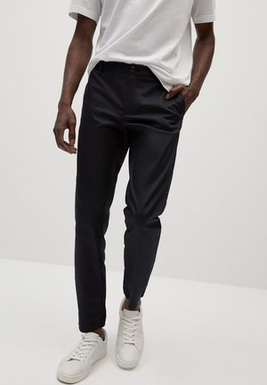IN CROPPED LÄNGE - Trousers - schwarz