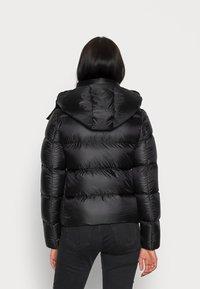 Calvin Klein Jeans - SHINY  - Down jacket - black - 2