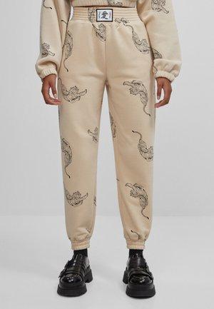MIT PRINT IN TIGEROPTIK  - Pantalon de survêtement - beige