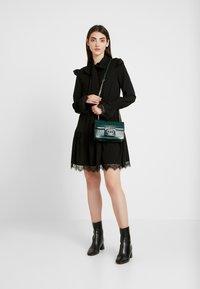 NA-KD - SMOCKED FLOUNCE DETAIL DRESS - Denní šaty - black - 2