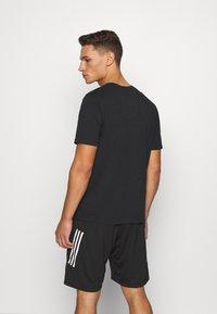 Hummel - HMLISAM - Print T-shirt - black - 2