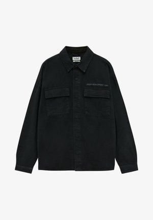 UNDER DEVELOPMENT - Shirt - black