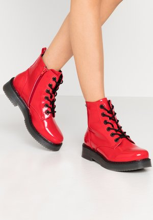 NERIA - Platform ankle boots - red