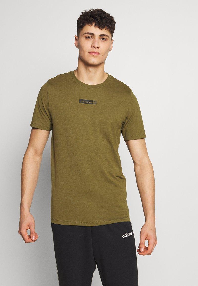 Jack & Jones Performance - JCOZSS TEE - Basic T-shirt - winter moss