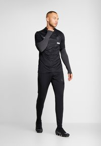 Nike Performance - DRY STRIKE DRILL - Sports shirt - black/anthracite - 1