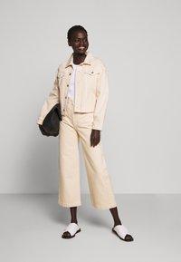 Proenza Schouler White Label - CULOTTE - Flared Jeans - sand - 1