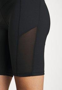 Hunkemöller - CYCLING SHORTS - Sports shorts - black - 4