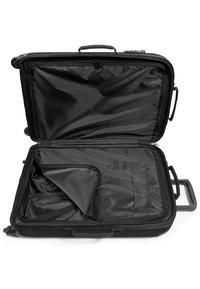 Eastpak - TRANZSHELL/CORE COLORS - Wheeled suitcase - black - 5