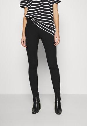 BJORG - Leggings - Trousers - black