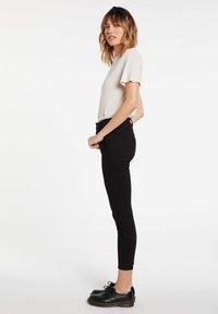Volcom - LIBERATOR HIGH RISE - Jeans Skinny Fit - premium_wash_black - 1