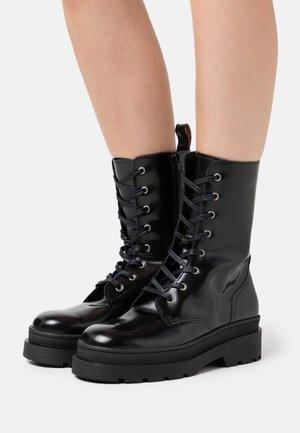 AUBRI - Platform ankle boots - black