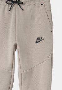Nike Sportswear - Tracksuit bottoms - desert sand - 2