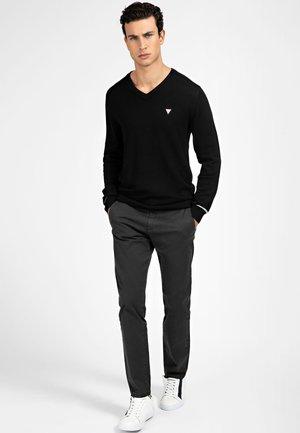 Spodnie materiałowe - mehrfarbig schwarz