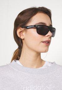 adidas Originals - Sunglasses - black/smoke - 1