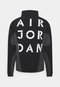 Jordan - Training jacket - black/dark smoke grey - 1