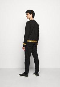 EA7 Emporio Armani - Sweatshirt - black/gold - 2