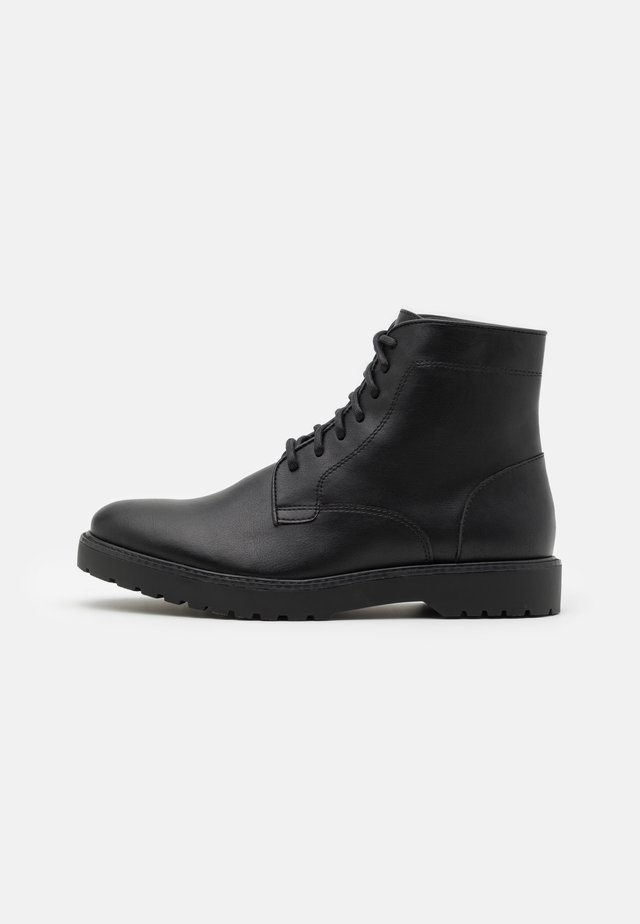 UNISEX - Lace-up ankle boots - black