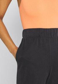 Monki - CLEO TROUSERS - Trousers - black dark - 4