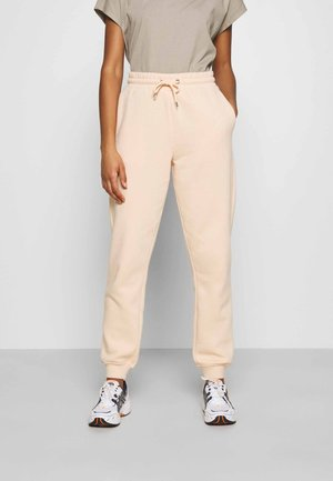 KARDI PANTS - Tracksuit bottoms - beige