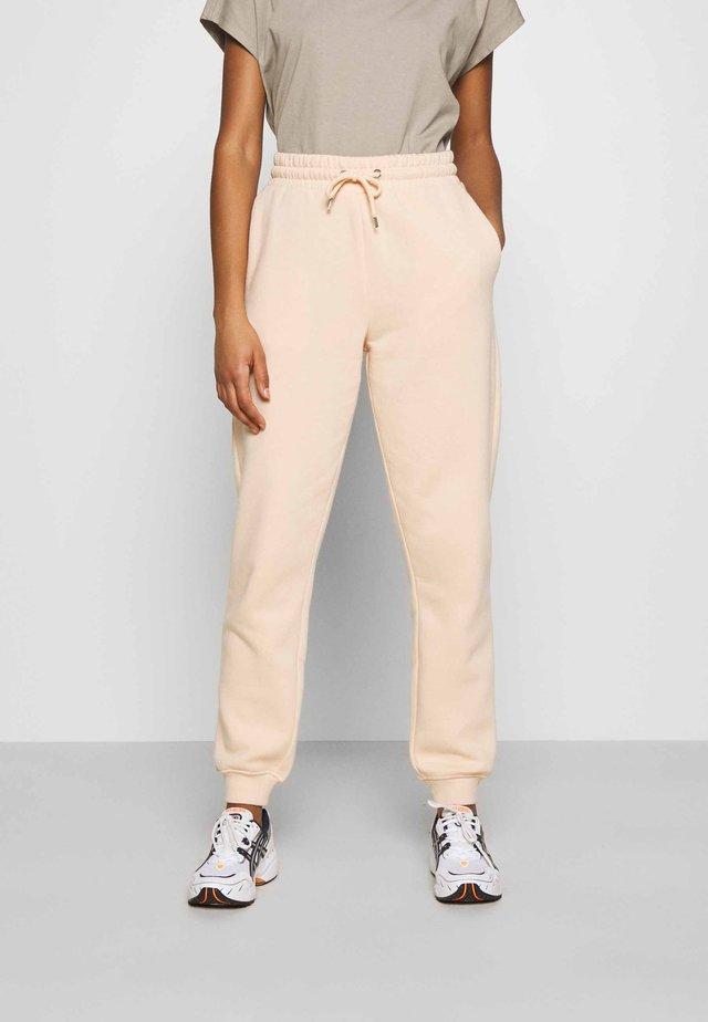KARDI PANTS - Spodnie treningowe - beige