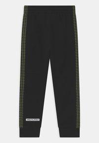 Nike Sportswear - GLOW IN THE DARK UNISEX - Tracksuit bottoms - black - 1