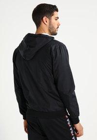 Urban Classics - Light jacket - black/white - 2