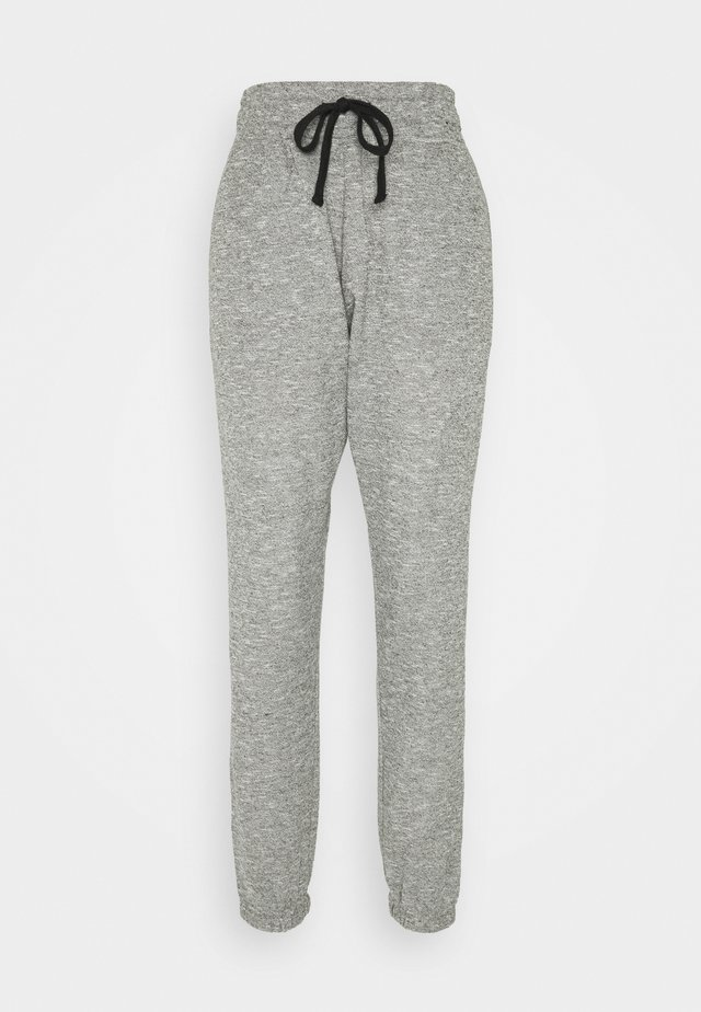 LIFESTYLE GYM TRACK PANTS - Pantalon de survêtement - black/varsity