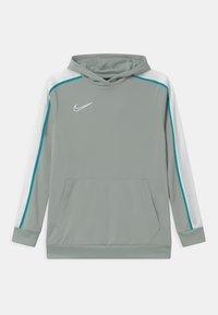 Nike Performance - HOODIE UNISEX - Sports shirt - light pumice/white - 0
